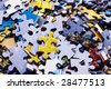 Task too difficult: pile of jigsaw puzzle pieces - stock photo