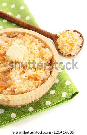 Taste rice porridge with pumpkin, isolated on white - stock photo