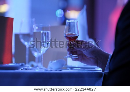 taste the brandy in glass - stock photo
