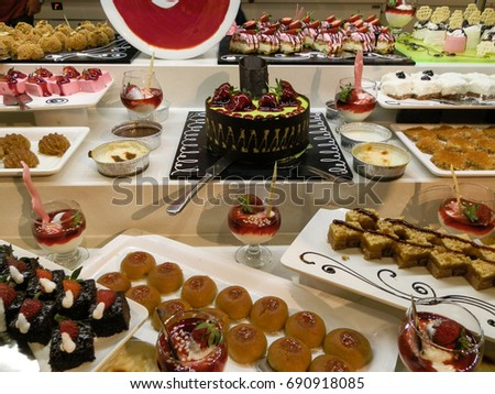 Tasteful cakes on cake table in turkish hotel.