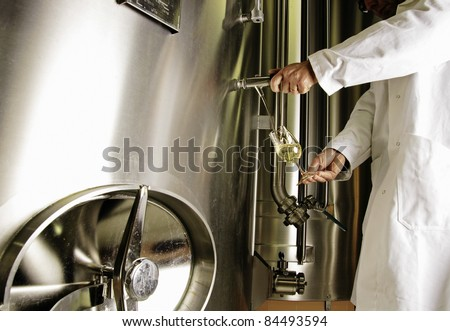 Tasting Champagne directly from a vat - stock photo