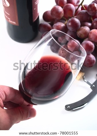 tasting chianti italian reserve wine, with grapes, corkscrew and bottle background - stock photo