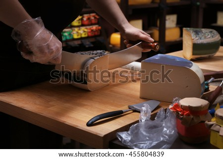 Tasting fresh cheese in cellar - stock photo