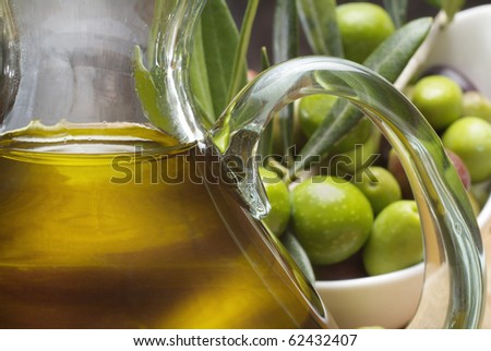 Tasting olive oil and freshly harvested olives.