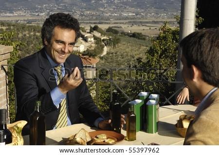 Tasting olives - stock photo