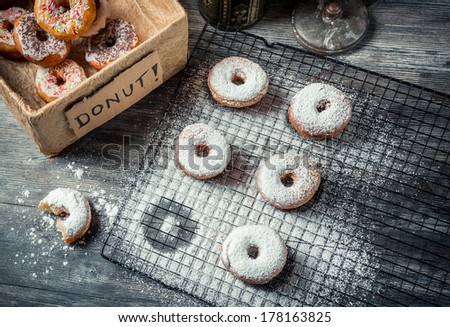 Tasting sweet donuts with icing sugar - stock photo