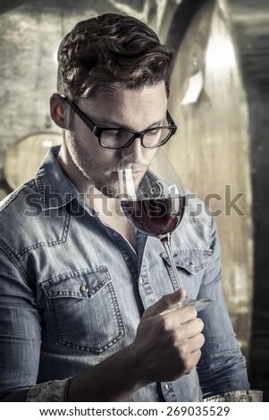 tasting wine  - stock photo