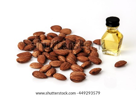 tasty almonds nuts and oil isolated on white background. - stock photo