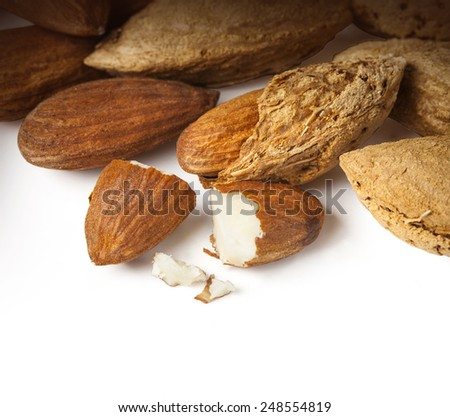 tasty almonds nuts isolated on white background with clipping path - stock photo