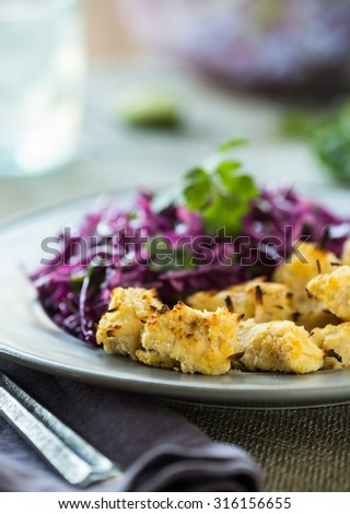 Tasty alternative to fried chicken nuggets with cabbage slaw - stock photo