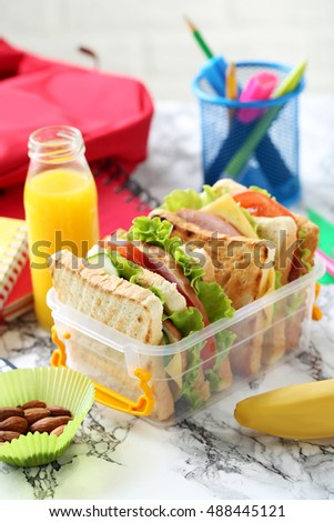 Tasty and fresh sandwiches on a grey table