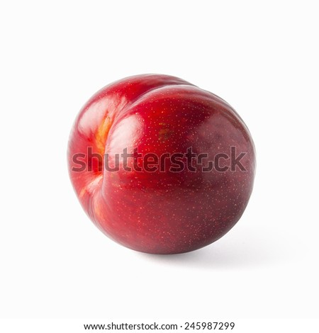 Tasty and glossy plum isolated on white - stock photo