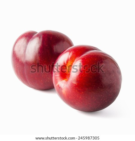 Tasty and glossy two plums isolated on white - stock photo