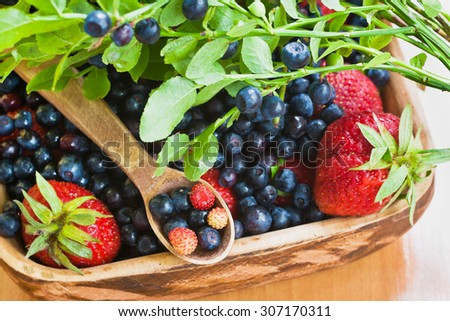 Tasty and healthy blueberries and strawberries - stock photo