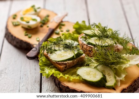 tasty and healthy breakfast served on a wooden board - stock photo