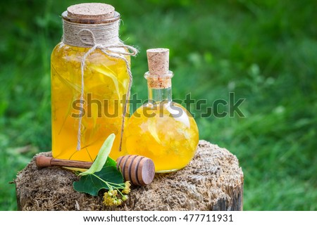 Tasty and homemade liqueur with honey, linden and alcohol