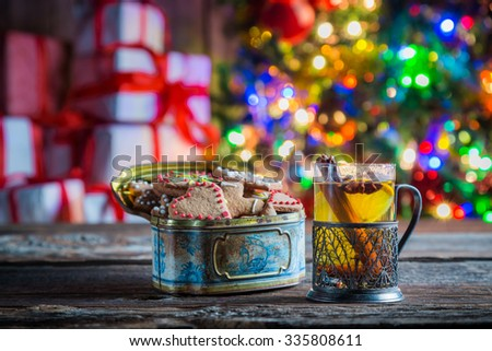 Tasty and sweet tea and gingerbread cookies at Christmas eve - stock photo