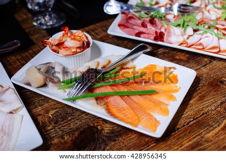 Tasty appetizer. Plate of red  fish Salmon fillet. Banquet table
