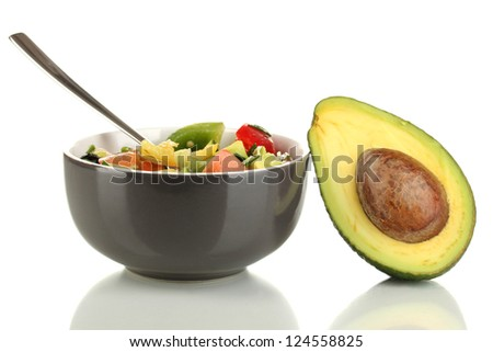 Tasty avocado salad in bowl  isolated on white