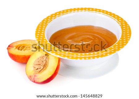 Tasty baby fruit puree isolated on white - stock photo