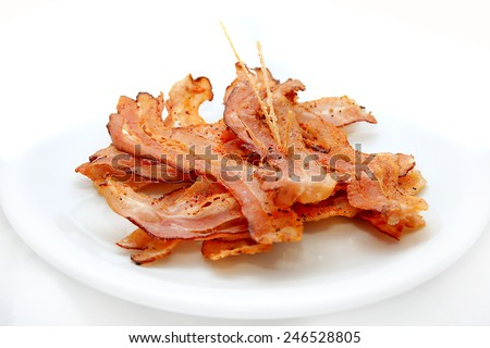 tasty bacon on white plate - stock photo