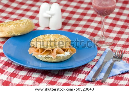 Tasty bagel with smoked salmon and cream cheese. - stock photo