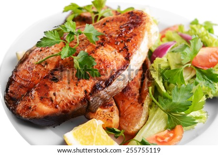 Tasty baked fish on plate close-up - stock photo