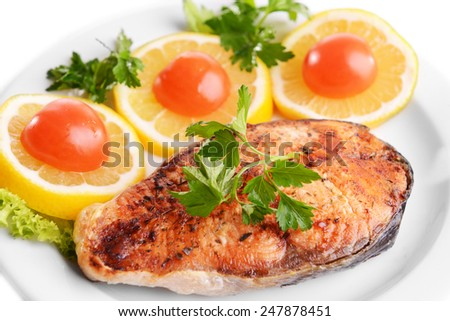 Tasty baked fish on plate isolated on white - stock photo