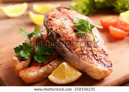 Tasty baked fish on table close-up - stock photo