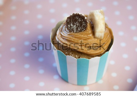 Tasty banana cupcakes with peanut butter frosting - stock photo