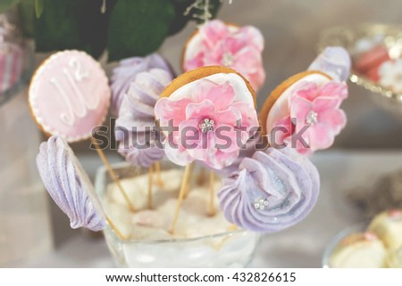 Tasty beautiful luxury flower sweet candy bar set on the table at the wedding ceremony in restaurant. Tasty vanilla milky desserts on the table. Confectionery business concept. - stock photo