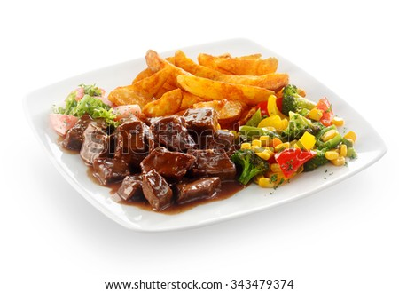 Tasty Beef Goulash Served With Mixed Fresh Vegetables And Golden French Fries On A Square White