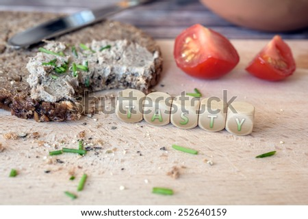 Tasty Bitten Off Wholemeal Bread With Spread - stock photo