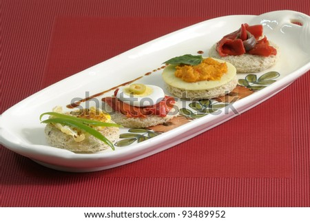 Tasty bread slices, with eggs, peppers and pate