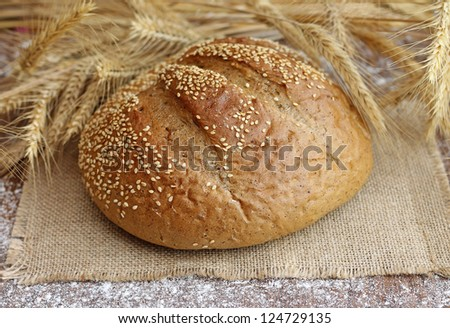 tasty bread with spikelets, close-up - stock photo