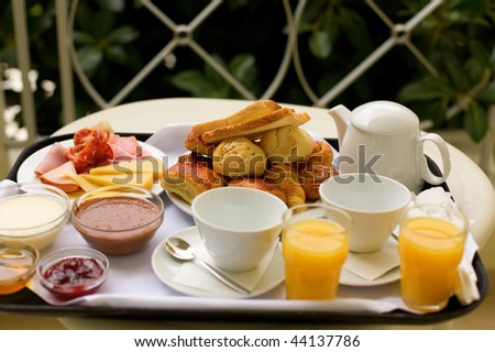 Tasty breakfast for two on the balcony or in the garden - stock photo