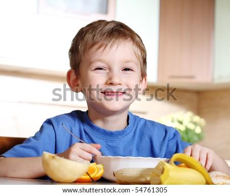 Tasty breakfast of little boy - stock photo