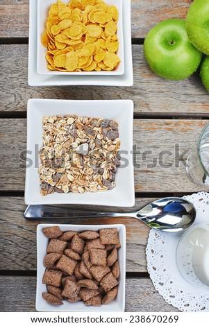 Tasty breakfast of muesli, fresh milk and green apples - stock photo