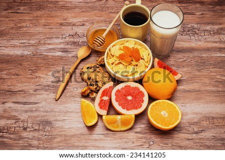 tasty breakfast with corn flakes, tea and fruits - stock photo