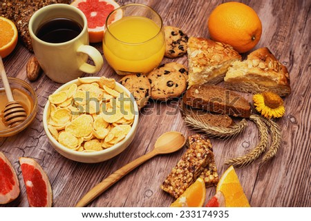 tasty breakfast with juice, corn flakes and pie - stock photo
