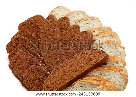 tasty brown and white wheat brad on white background - stock photo