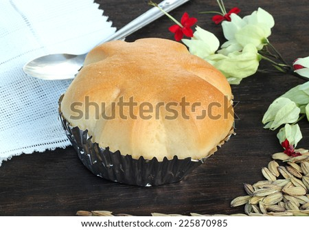 tasty bun isolated on dark wooden board. - stock photo
