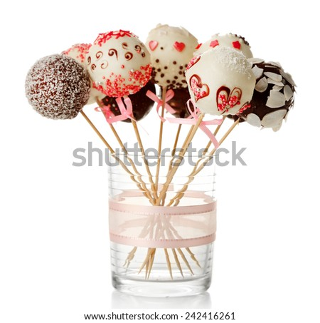 Tasty cake pops in glass, isolated on white - stock photo