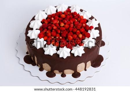 tasty cake with fresh wild strawberries and merengue - stock photo