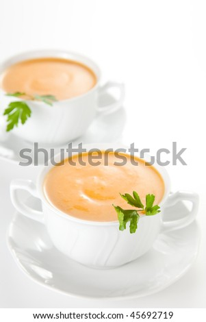 tasty Carrots puree with parsley on white bowl