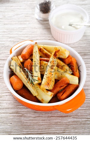 Tasty carrots with roasted parsnips, food - stock photo