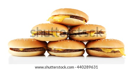 Tasty cheeseburgers, isolated on white - stock photo