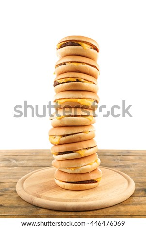 Tasty cheeseburgers on cutting board, isolated on white