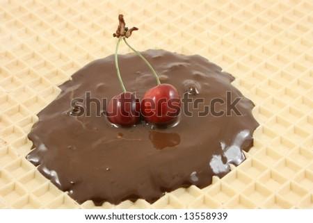 tasty cherry with brown chocolate - stock photo