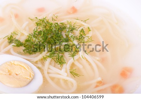 Tasty chicken clear soup with egg in plate - stock photo